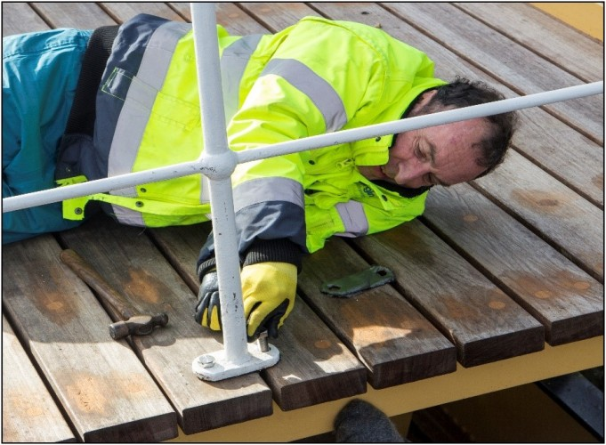 Volunteer at Work Fitting Handrails